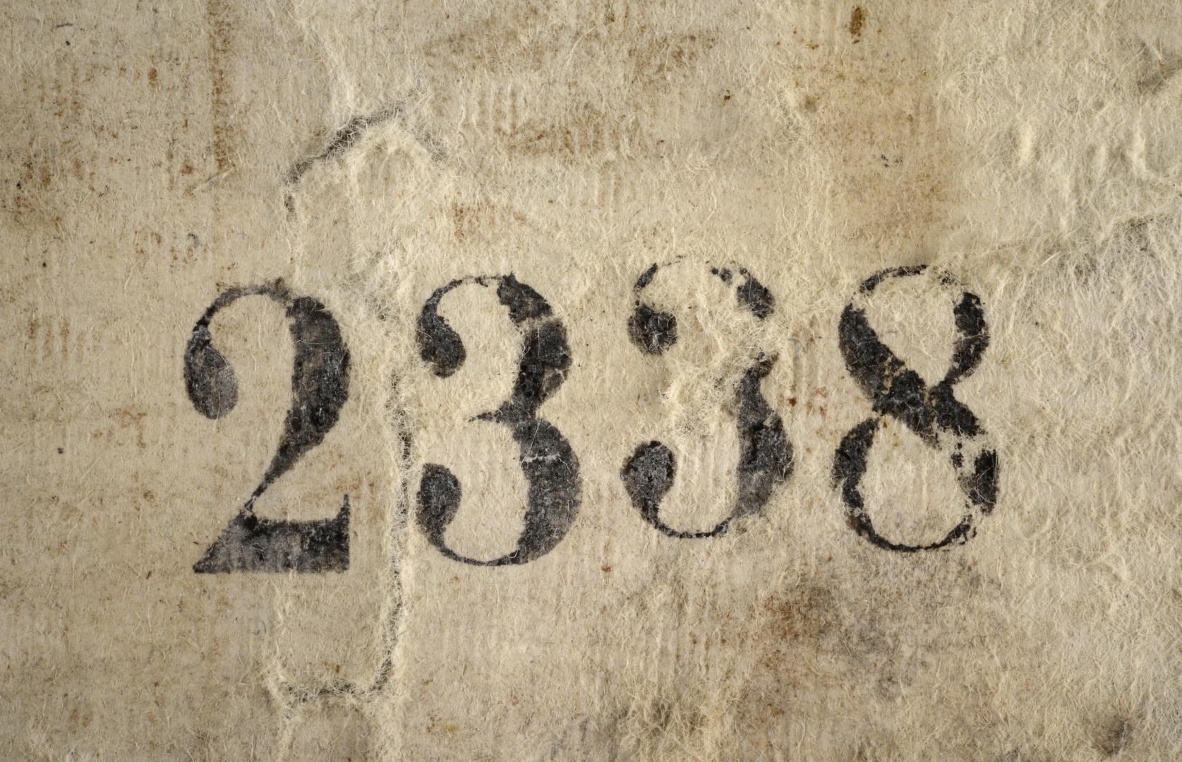fig 3.When the wallpaper was removed from the wall the producer's sign and the serial number –  2338 – were discovered. The producer's sign is, unfortunately, almost illegible. The wallpaper imitating a grained wall panel that was found in the entrance hall of Vääna Manor was made at the same factory and on that the sign is clearly legible – 'C.Π.Ƃ.Π. T. 1880'.