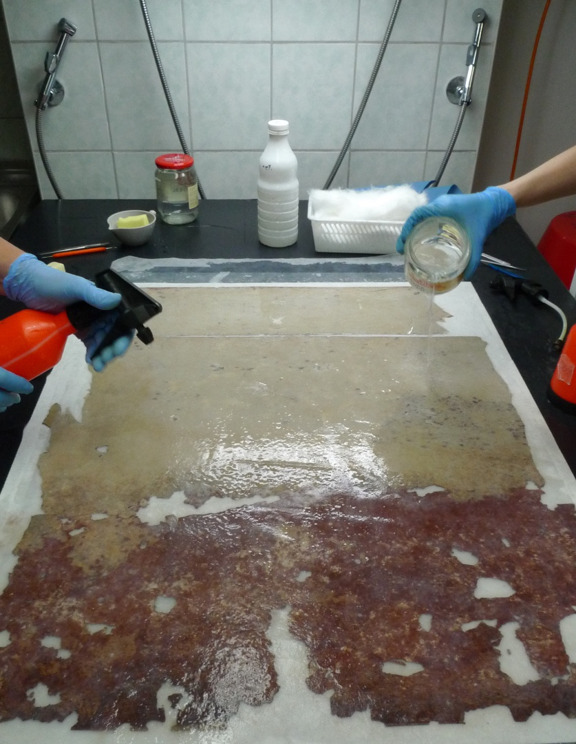 fig 40. The format of the flocking wallpaper allowed us to wash it on the vacuum table.  Washing  was started on the back side.