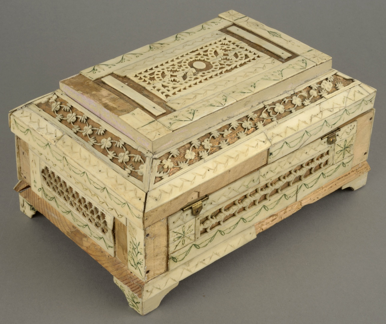 fig 5. The casket (in the article) with gold foil before conservation. The back of the casket.  Some details were loose and some missing, the metal hinges were broken