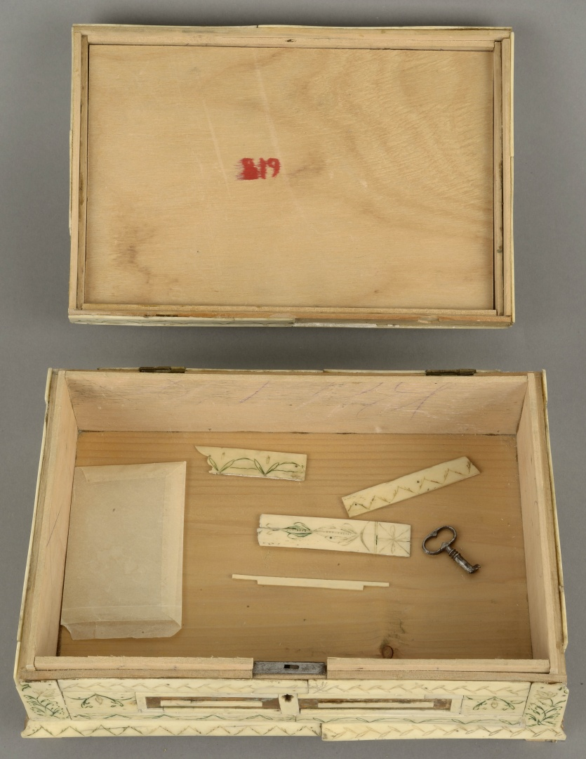 fig 6. The lid had become loose, some detached details, the key and a paper bag with pieces of bone lace were inside