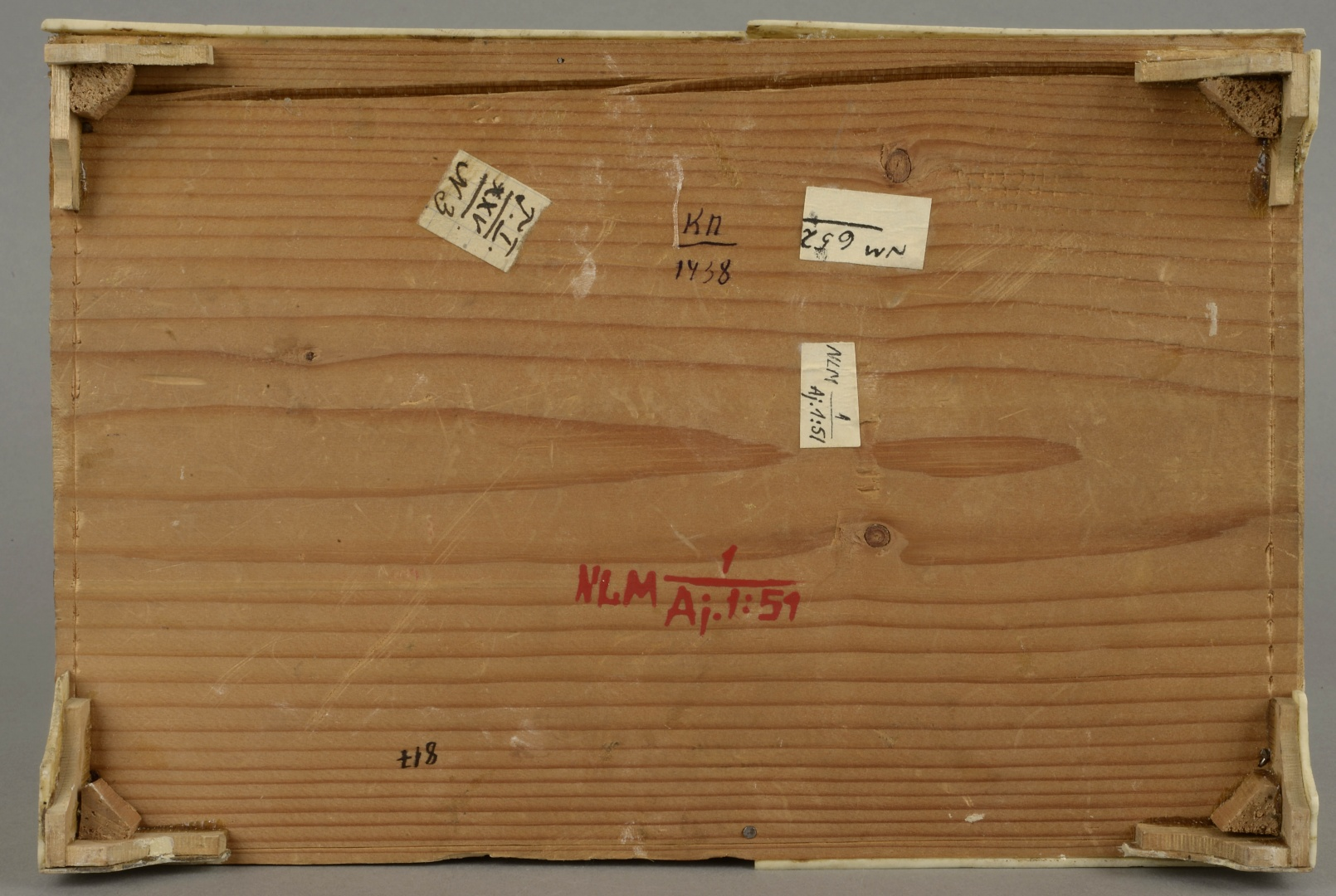 fig 8. Various markings made at different times on the bottom of the casket. The legs of the casket were plain wooden slats forming a triangle that was supported by small wooden blocks