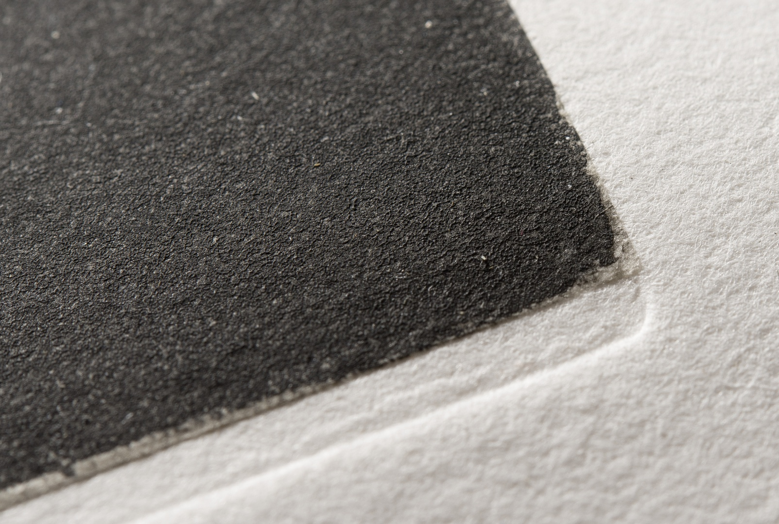 fig 15. Observation showed that double-layered paper had been used – the not-glued rag-paper has the Chine-collé on gampi paper on top.