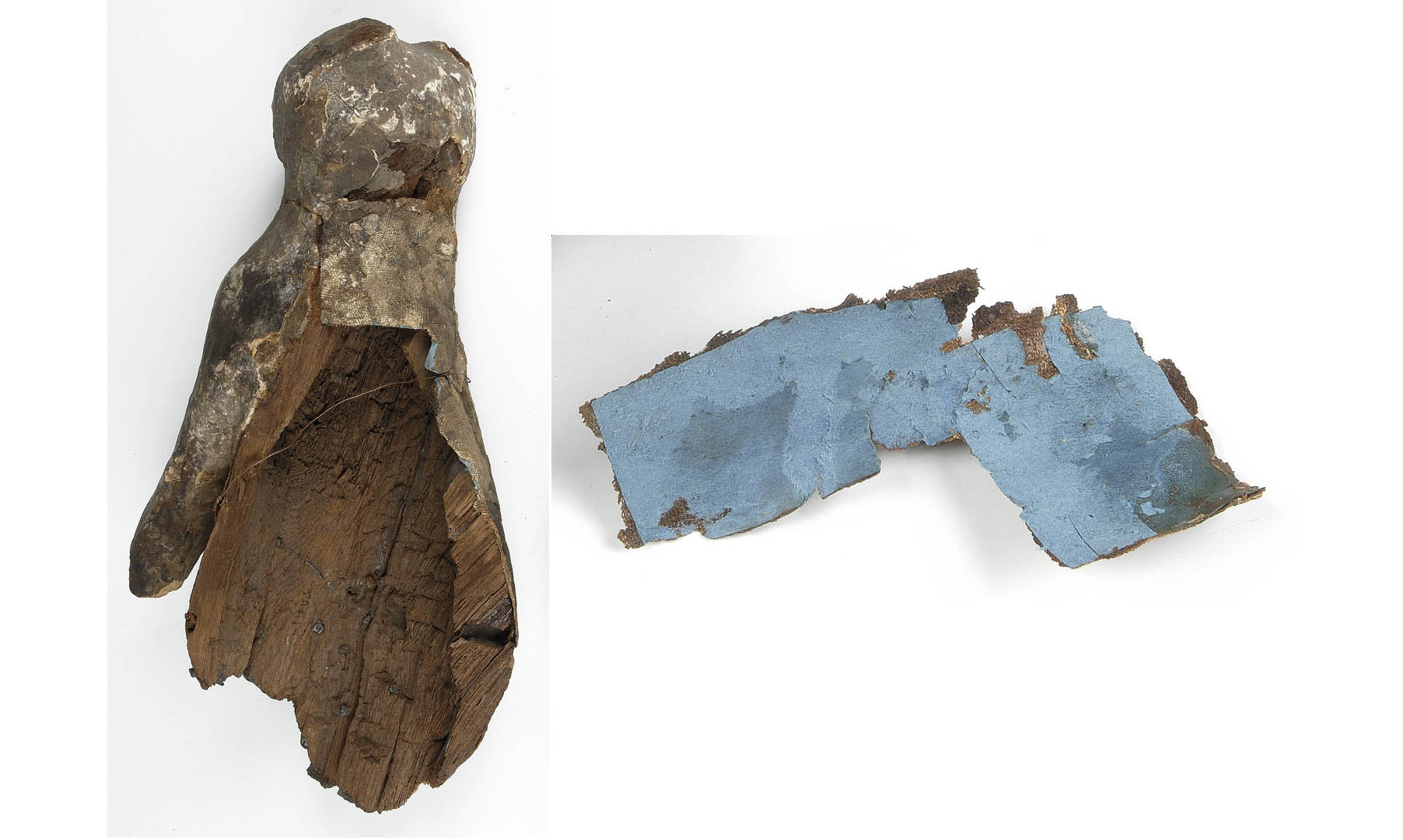 fig 6.The sarcophagus had suffered several repairs in the past. The hole on the scruff of the figure had been filled with blue cardboard and covered with a piece of the original linen fabric.