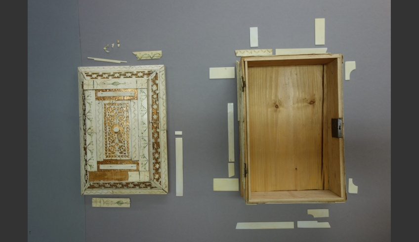 fig 12. Missing details were replaced with new ones cut out of bone. The photo shows the old and the new details at their proper places – 10 details from the lid and 13 details from the sides of the casket before re-gluing