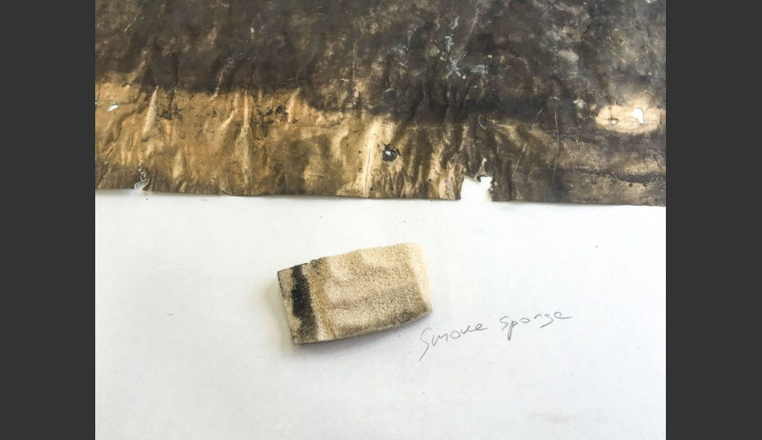 fig 13. The metal paper on the bottom of the box was dirty and deformed, torn and corroded. First it was processed with a dry sponge.