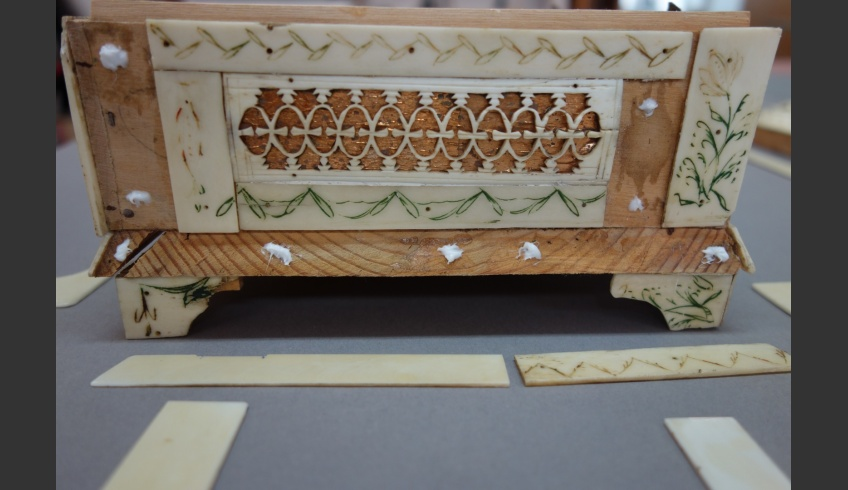 fig 13. The old and new details were fixed on the casket with dots of PVA glue that would allow them to be easily removed when necessary