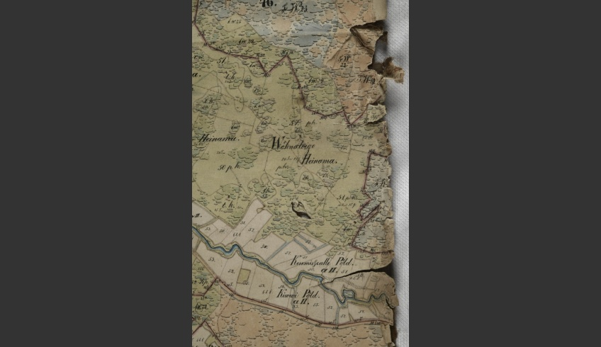 ill 8. The map had been halved in the middle and the edges were creased, had losses and rips in them.